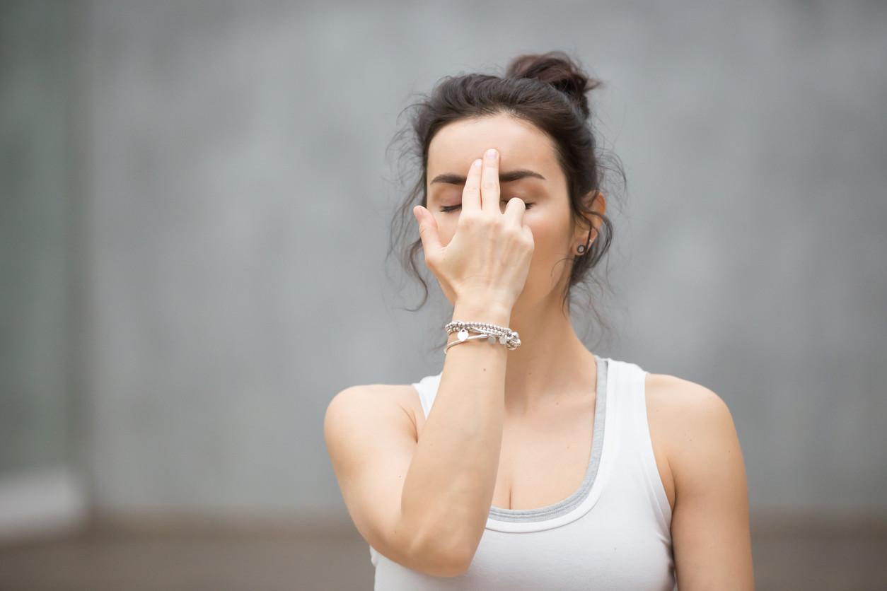 yoga-alternate-breathing-meditating-iStock-636607546